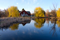 Farmhouse and Willows on Pond at Dodge